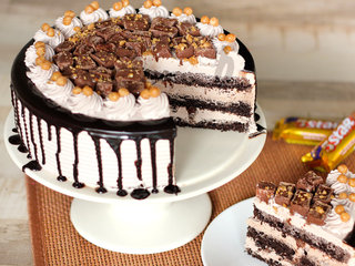Sliced View of Caramel Crunch Cream Cake-Five Star Cake