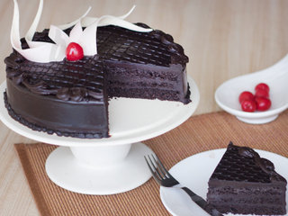 Sliced View of Delectable Truffle - Round Chocolate Truffle Cake