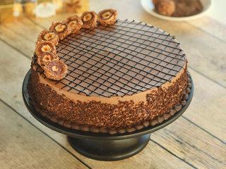 Zoom View of Merry Round Ferrero Rocher Cake in Noida