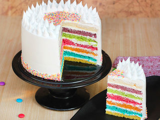 Sliced View of Rainbow Sprinkles Cake