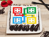 Square-shaped Ludo poster cake