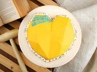Top View of Heart Shaped Pineapple Pinata Cake