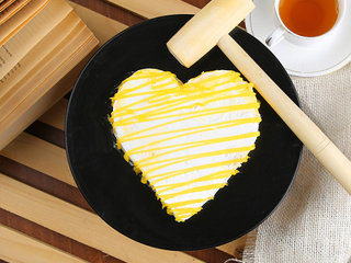 Top View of Heart Shaped Pineapple Pinata Cake with Hammer