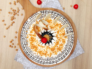 Top View of Creamy Addiction - Round Shaped Butterscotch Cake Design in Noida