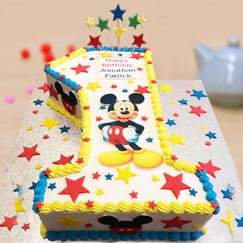 https://media.bakingo.com/sites/default/files/1st-birthday-mickey-mouse-party-cake-part1808flav.jpg