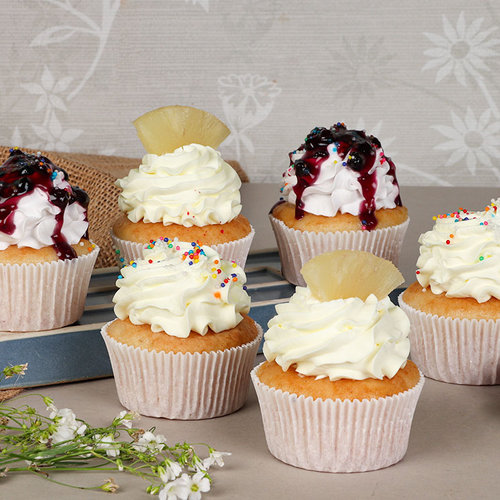 https://media.bakingo.com/sites/default/files/6-blueberry-pineapple-vanilla-cupcakes-cupc1777flav-C.jpg