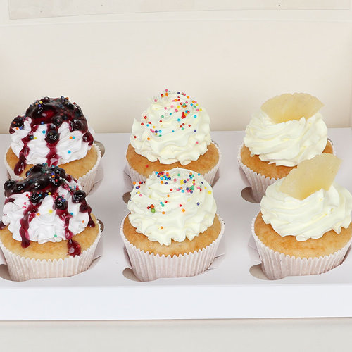 https://media.bakingo.com/sites/default/files/6-blueberry-pineapple-vanilla-cupcakes-cupc1777flav-D.jpg