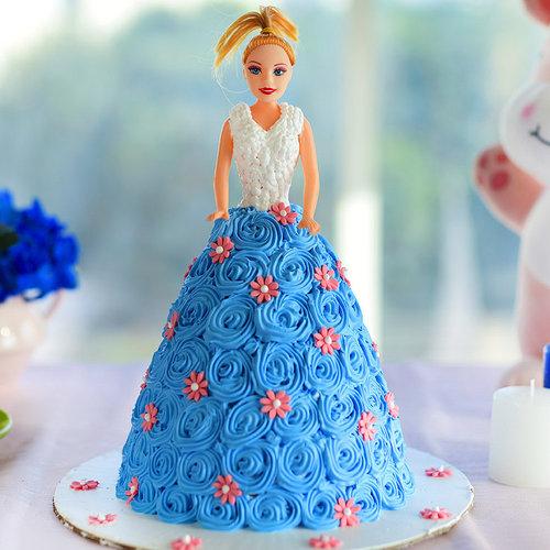 https://media.bakingo.com/sites/default/files/barbie-doll-cream-cake-them1045flav-A_0.jpg