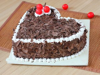 Side View of Heart Shaped Black Forest Cake with Choco Flakes Toppings