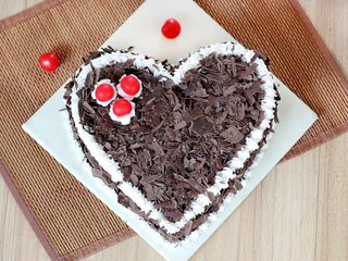 Top View of Heart Shaped Black Forest Cake with Choco Flakes Toppings