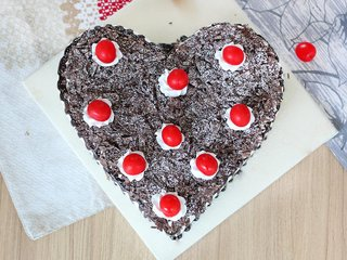 Top View of Heart Shaped Black Forest Cake with Cherry Toppings