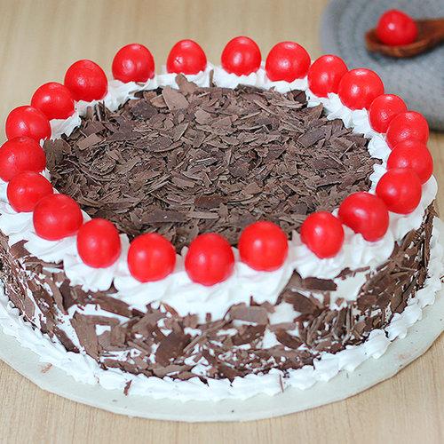 https://media.bakingo.com/sites/default/files/black-forest-round-shaped-cake-4-cake1999blac-A.jpg