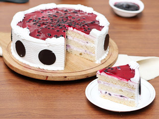Sliced View of Chopped Blueberries N Blueberry Puree Round Cake
