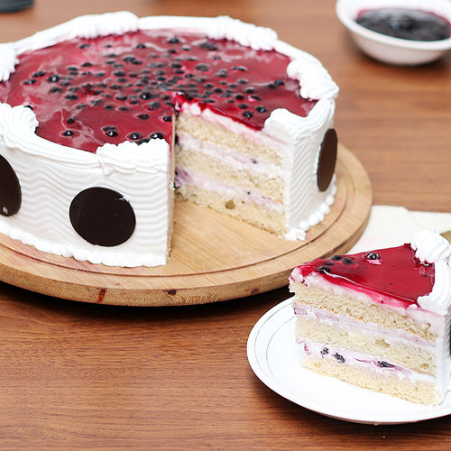 https://media.bakingo.com/sites/default/files/blueberry-cake-3-ghaziabad-cake1028blue-B.jpg