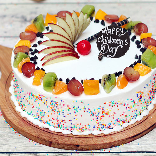 https://media.bakingo.com/sites/default/files/childrens-day-vanilla-fruit-cake-cake965frui-A.jpg