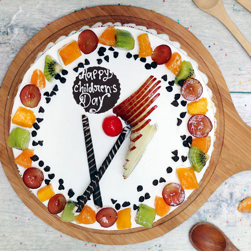 https://media.bakingo.com/sites/default/files/childrens-day-vanilla-fruit-cake-cake965frui-B.jpg