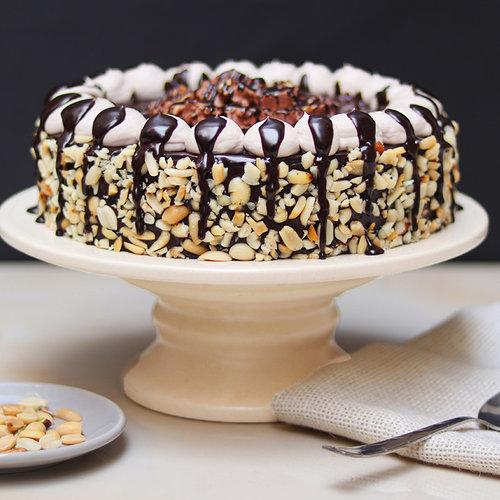 https://media.bakingo.com/sites/default/files/chocolate-overdosed-snickers-cake-cake1916choc-B.jpg