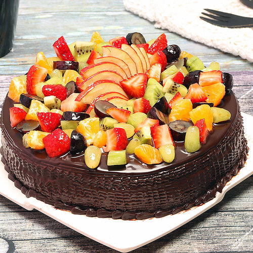 https://media.bakingo.com/sites/default/files/chocolate-truffle-fruit-cake-cake0756chfr-B (2).jpg