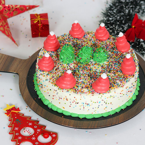 https://media.bakingo.com/sites/default/files/christmas-tree-vanilla-cake-cake1648vani-A.jpg