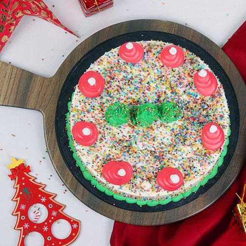 https://media.bakingo.com/sites/default/files/christmas-tree-vanilla-cake-cake1648vani-C.jpg