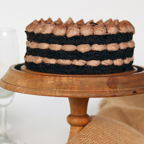 https://media.bakingo.com/sites/default/files/delicious-moist-chocolate-cake-cake2021choc-B.jpg