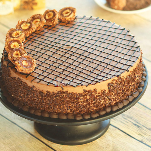 https://media.bakingo.com/sites/default/files/ferrero-rocher-cake-cake1277choc-A.jpg