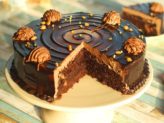 Side Sliced View of Round Chocolate N Ferreor Rocher Cake
