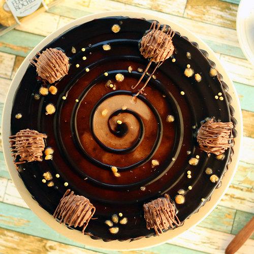 https://media.bakingo.com/sites/default/files/ferrero-rocher-choco-cake-cake1268choc-B.jpg