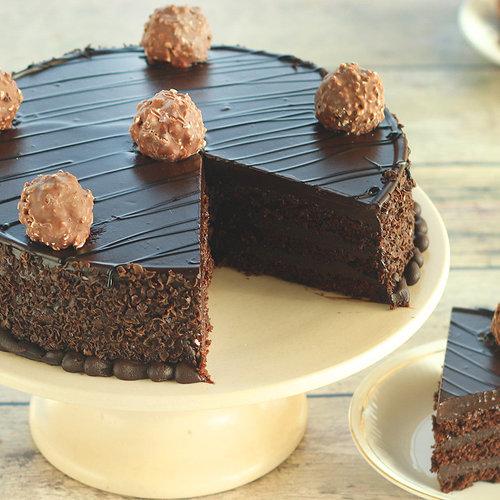 https://media.bakingo.com/sites/default/files/ferrero-rocher-chocolate-cake-cake1275choc-C.jpg