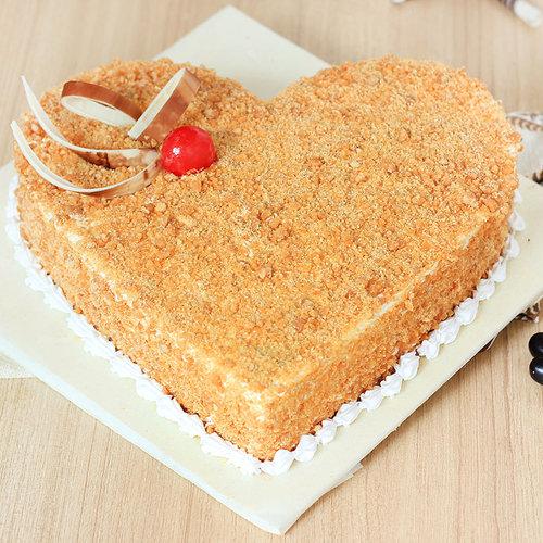 https://media.bakingo.com/sites/default/files/heart-shaped-butterscotch-cake-1-cake1518butt-A.jpg