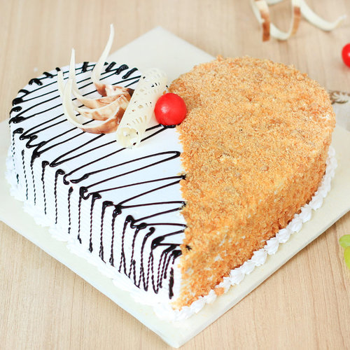 https://media.bakingo.com/sites/default/files/heart-shaped-butterscotch-cake-2-cake1942butt-A.jpg