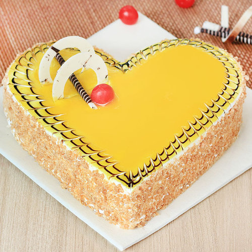 https://media.bakingo.com/sites/default/files/heart-shaped-butterscotch-cake-3-cake1521butt-A.jpg