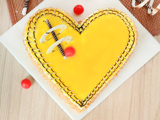 Top View of Heart Shaped Butterscotch Cake in Delhi