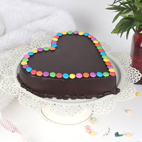 https://media.bakingo.com/sites/default/files/heart-shaped-choco-gems-cake-cake1875choc-B.jpg