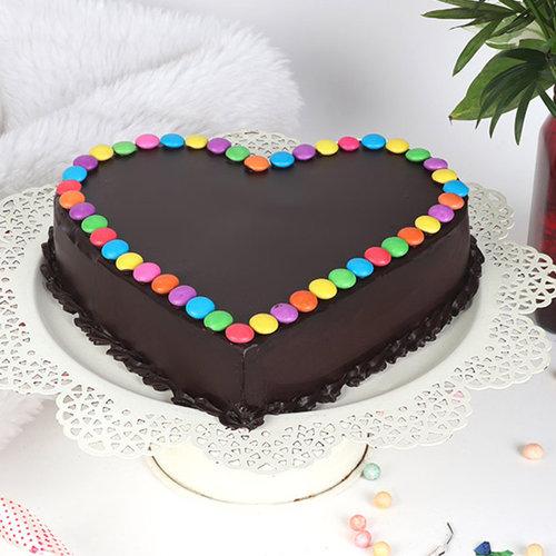 https://media.bakingo.com/sites/default/files/heart-shaped-choco-gems-cake-cake2011choc-A.jpg
