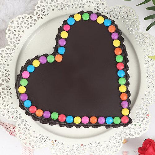 https://media.bakingo.com/sites/default/files/heart-shaped-choco-gems-cake-cake2011choc-C.jpg