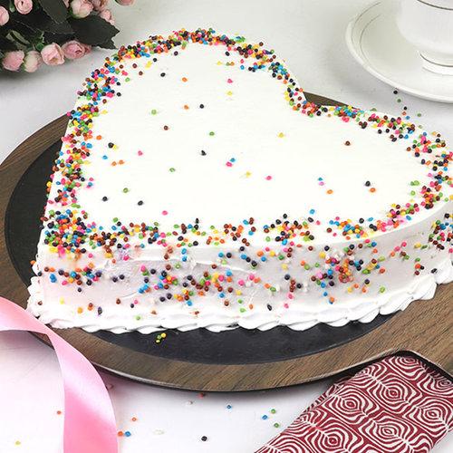 https://media.bakingo.com/sites/default/files/heart-shaped-pineapple-cake-cake1864pine-B.jpg