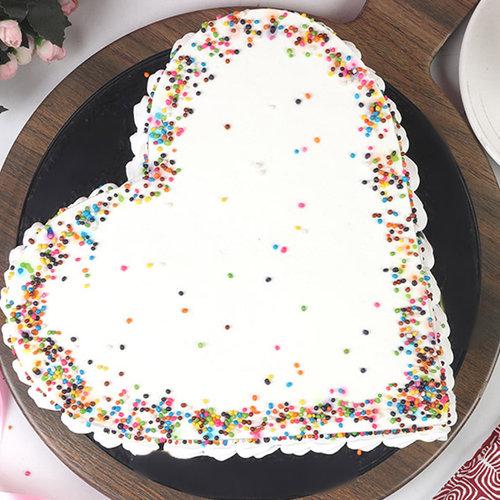 https://media.bakingo.com/sites/default/files/heart-shaped-pineapple-cake-cake2000pine-C.jpg