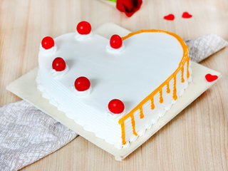 Heart Shaped Vanilla Flavored Cake with Cherries on Top