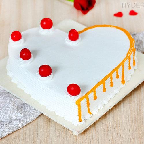 https://media.bakingo.com/sites/default/files/heart-shaped-vanilla-cake-2-in-hyderabad-cake1190flav-a.jpg