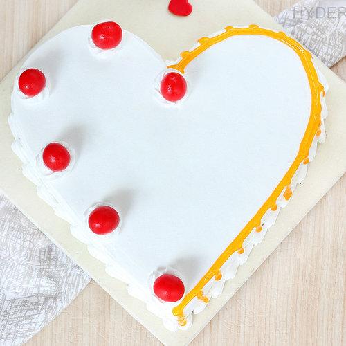 https://media.bakingo.com/sites/default/files/heart-shaped-vanilla-cake-2-in-hyderabad-cake1190flav-b.jpg