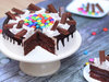 Sliced View of Delicious Kitkat Gems Cake
