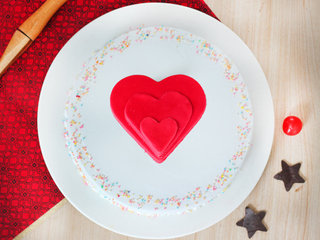 Top View of Vanilla cream cake with 3 fondant hearts