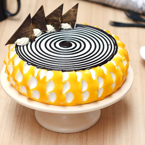 https://media.bakingo.com/sites/default/files/mango-vegan-cake-bangalore-cake987mang-A.jpg
