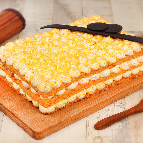 https://media.bakingo.com/sites/default/files/orange-bubble-rectangle-cake-cake0730oran-A.jpg