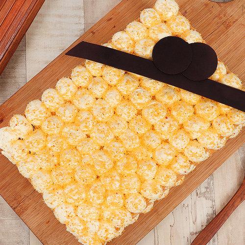 https://media.bakingo.com/sites/default/files/orange-bubble-rectangle-cake-in-noida-cake1120flav-b.jpg