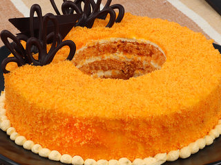 Zoomed View of Donut Like Orange Cake N Chocolate Topping