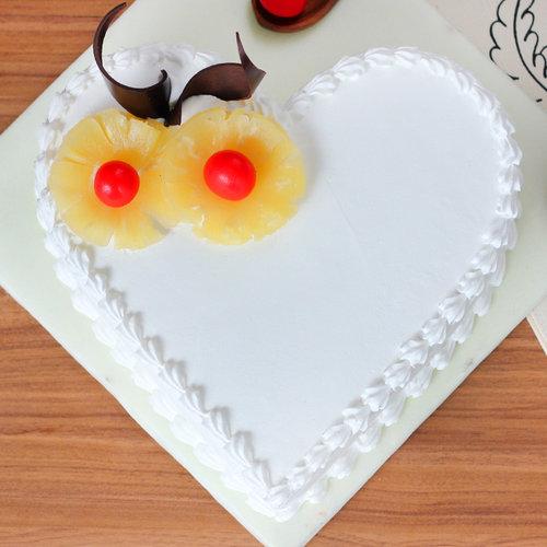 https://media.bakingo.com/sites/default/files/pineapple-heart-shaped-cake-1-cake1519pine-C.jpg