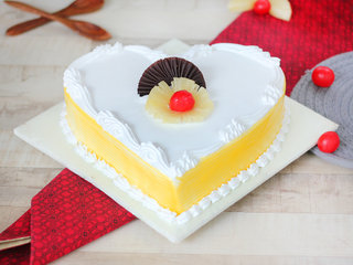 Heart Shaped Pineapple Cake with Cherry and Chocolate Toppings