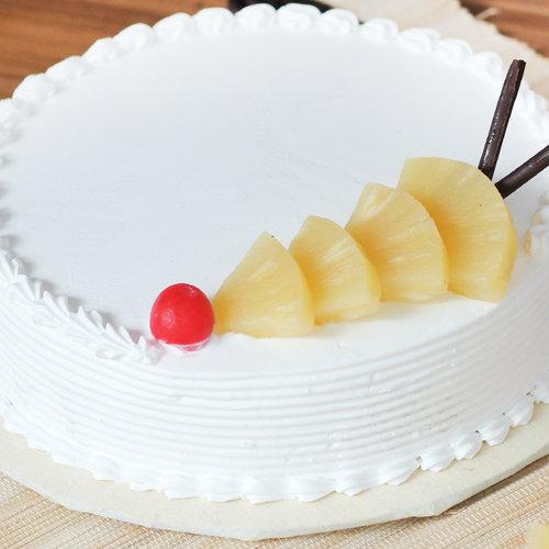 https://media.bakingo.com/sites/default/files/pineapple-round-shaped-cake-2-cake1517pine-C.jpg